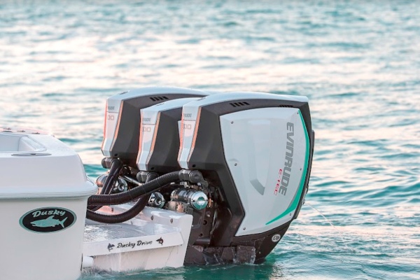 Triple Evinrude Engines in water